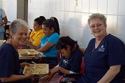 Srs Margo Young, left, and Karen Elliott with patients at Santo Hermano Pedro