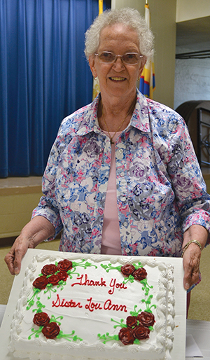 sr-lou-ann-roof-with-cake