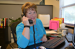 Peg Birkemeyer answers the phone at C.A.O.